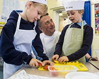 Kids cooking with a chef