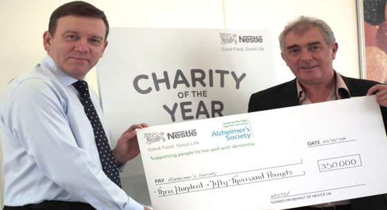 Paul Grimwoof presents cheque to Alzheimer's Society