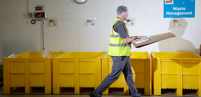 three men moving boxes in warehouse