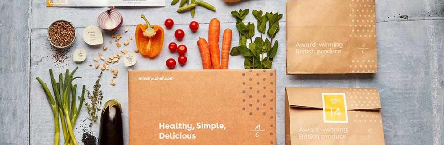 mindful chef box with vegetables and ingredients coming out of the box
