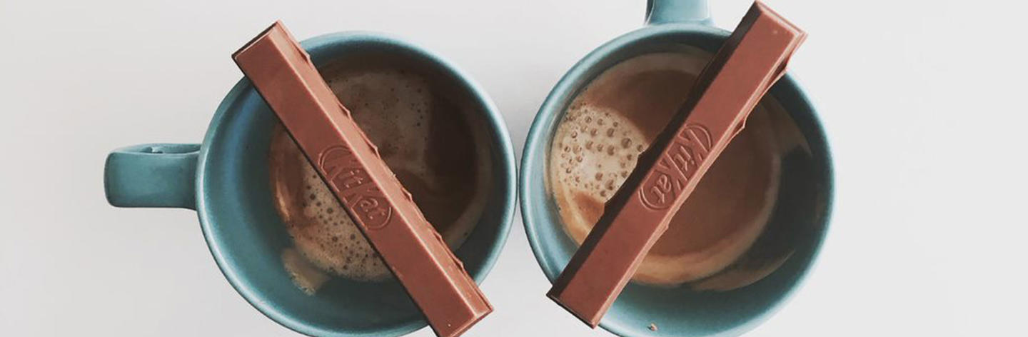Cups of coffee with KitKats