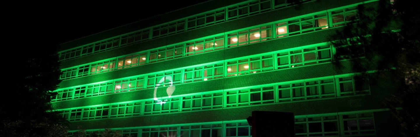 Recycle Now logo on Nestlé House York in green light