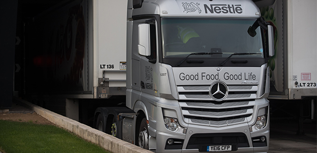 truck pulling out from nestle european transport hub at york